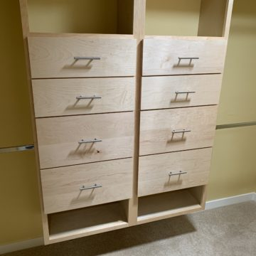 custom wood cabinets in the closet